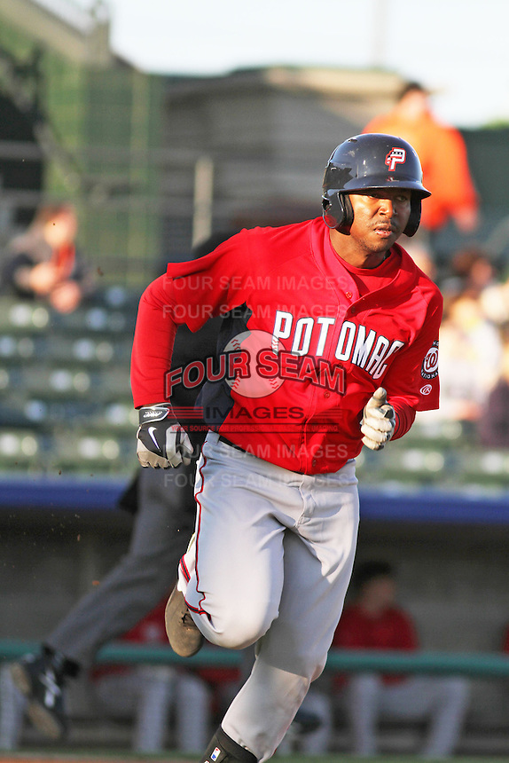 Potomac Nationals infielder Oscar Tejada #8 runs to first during a game against the Myrtle Beach Pelicans at Ticketreturn.com Field at Pelicans Ballpark on April 16, 2014 in Myrtle Beach, South Carolina. Potomac defeated Myrtle Beach 7-3. (Robert Gurganus/Four Seam Images)