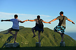 Orchid Island (蘭嶼), Taiwan -- Taiwanese tourists frolicking in the late afternoon sun at the Orchid Island weather station.