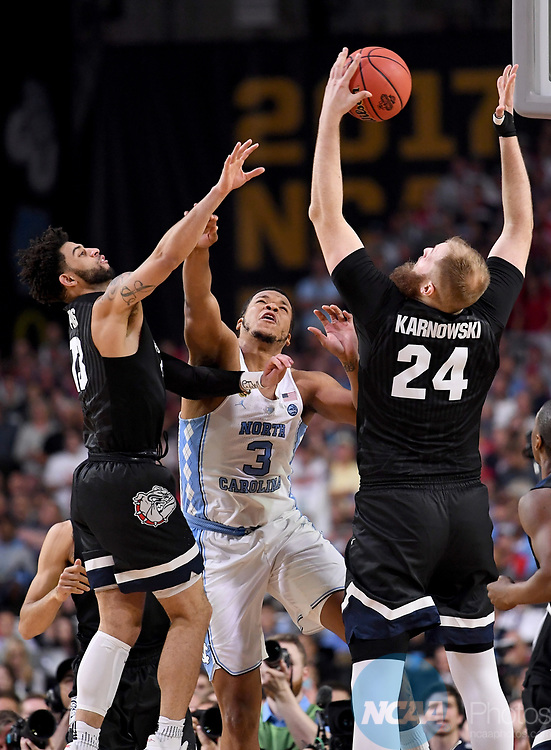 GLENDALE, AZ - APRIL 03: Przemek Karnowski #24 of the Gonzaga Bulldogs grabs a rebound against the North Carolina Tar Heels during the 2017 NCAA Men's Final Four National Championship game at University of Phoenix Stadium on April 3, 2017 in Glendale, Arizona.  (Photo by Jamie Schwaberow/NCAA Photos via Getty Images)