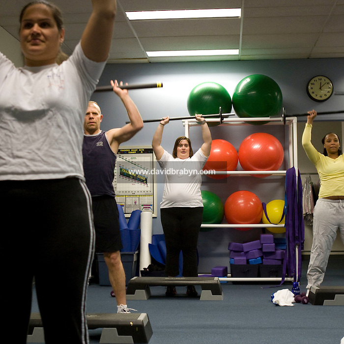 Employees take a fitness clas in the fitness center at the Pitney Bowes headquarters in Stamford, CT, United States, 7 October 2008.
