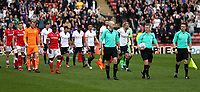 Todays match Officials lead the teams out at the start of todays match<br /> <br /> Photographer Rachel Holborn/CameraSport<br /> <br /> The EFL Sky Bet Championship - Barnsley v Bolton Wanderers - Saturday 14th April 2018 - Oakwell - Barnsley<br /> <br /> World Copyright &copy; 2018 CameraSport. All rights reserved. 43 Linden Ave. Countesthorpe. Leicester. England. LE8 5PG - Tel: +44 (0) 116 277 4147 - admin@camerasport.com - www.camerasport.com