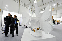 HONG KONG - MARCH 13:  Visitors take a picture of sculpture 'Skull' by Philippe Pasqua in art fair Art Central on its preview day on March 13, 2015 in Hong Kong, Hong Kong.  (Photo by Lucas Schifres/Getty Images)