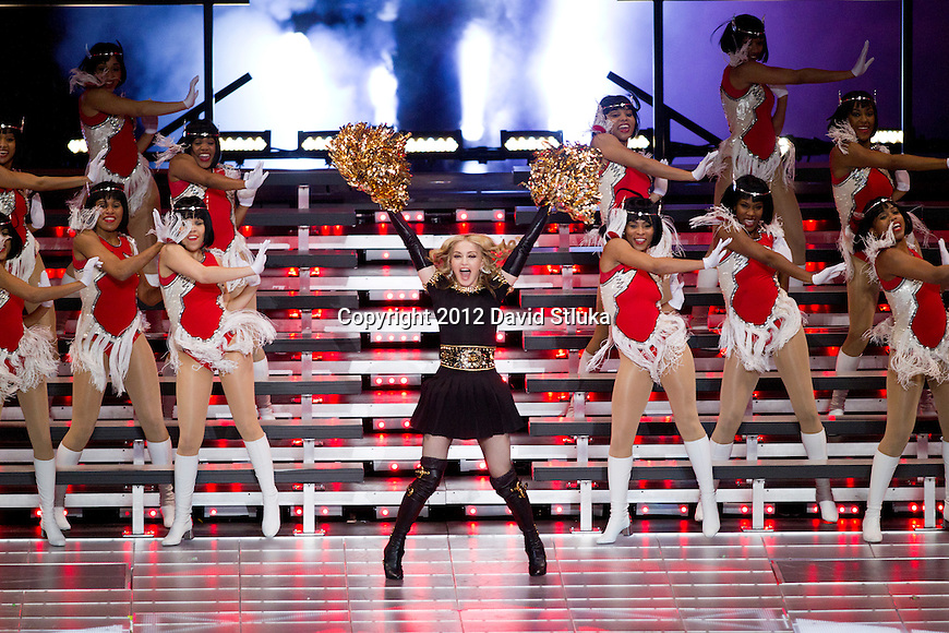 Music recording artist Madonna performs during halftime of the NFL Super Bowl XLVI football game between the New York Giants and the New England Patriots on Sunday, Feb. 5, 2012, in Indianapolis. The Giants won 21-17 (AP Photo/David Stluka)...