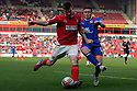 Andy Butler of Walsall is challenged by Craig Reid of Stevenage. - Walsall v Stevenage - npower League 1 - Banks's Stadium, Walsall - 24th March, 2012  .© Kevin Coleman 2012