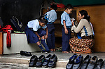 A woman who works at an orphanage in Pokhara, Nepal helps children dress and get ready for school.