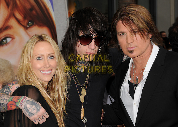 "LETICIA ""TISH"" CYRUS, TRACE CYRUS & BILLY RAY BYRUS .27 October 2010 - After 17 years of marriage, Miley Cyrus' parents, Billy Ray and Tish Cyrus, are divorcing. In the divorce papers filed in Tennessee citing irreconcilable differences, Billy Ray seeks to ""share the care, custody and control"" of the three minor children he has with wife Tish: Miley, who turns 18 in November, Braison, 16, and Noah, 10. (The pair have three older children from previous relationships). File Photo: 02 April 2009 - Hollywood, CA. Leticia Cyrus, Trace Cyrus and Billy Ray Cyrus. ""The Hannah Montana Movie"" Los Angeles Premiere held at the El Capitan Theatre. .half length mom mum mother father dad kid sunglasses tattoos arm around smiling black white shirt exes ex wife husband couple splitting up split .CAP/ADM/BP.©Byron Purvis/AdMedia/Capital Pictures."
