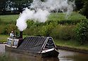 12/06/14 <br /> <br /> As storm clouds gather and temperatures continue to rise it is a truly hot and steamy day for crew members of President, Britain's oldest fully restored, steam narrowboat, as they navigate their way to the top of a flight of 15 lock gates at Audlem on The Shropshire and Union Canal in Cheshire.<br /> <br /> All Rights Reserved - F Stop Press.  www.fstoppress.com. Tel: +44 (0)1335 300098