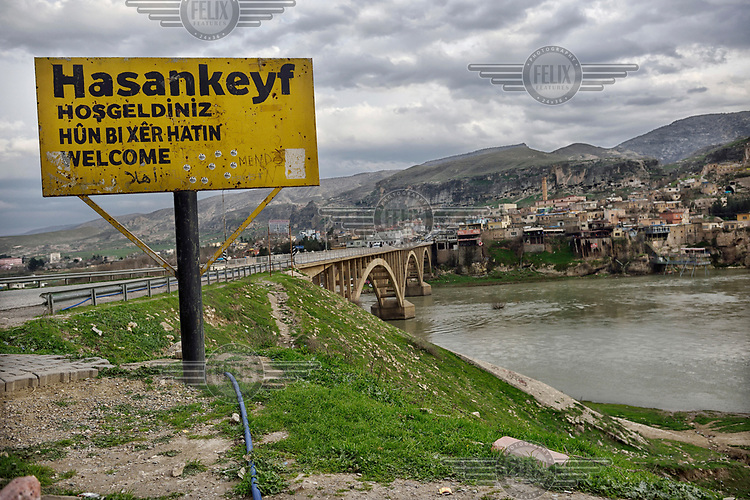 A sign on the north bank of the Tigris River welcoming people to Hasankeyf. Much of the town will be submerged beneath 60 metres (200 feet) of water following the completion of the Ilisu hydroelectric dam, 96 kilometres (60 miles) downstream.