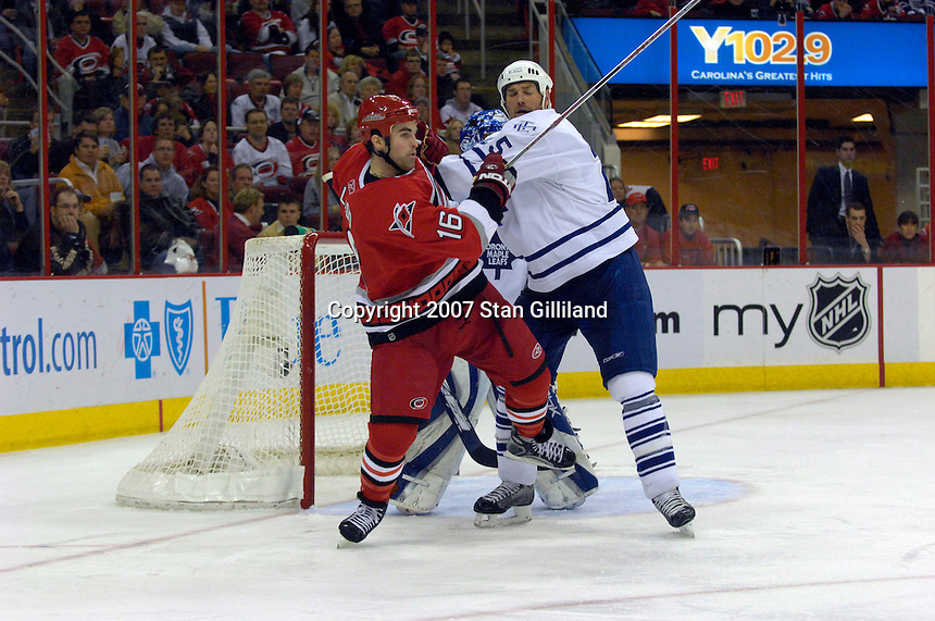 Carolina Hurricanes' Andrew Ladd (16) is pushed in the crease by the Toronto Maple Leafs' Hal Gill Tuesday, Jan. 30, 2007 at the RBC Center in Raleigh. The Leafs won 4-1.