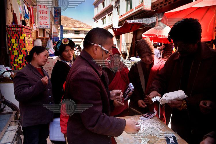 A man sells gadgets at a market in Ganze.