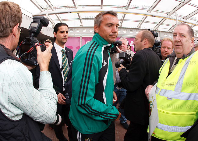 Rapid Vienna boss Peter Pacult strides past the Scottish media without answering any questions