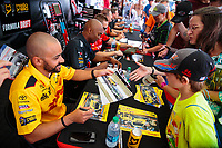 Sep 1, 2018; Clermont, IN, USA; NHRA funny car driver J.R. Todd signs autographs during qualifying for the US Nationals at Lucas Oil Raceway. Mandatory Credit: Mark J. Rebilas-USA TODAY Sports