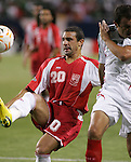 21 June 2007:  Gudeloupe's Michael Tacalfred (20) clears the ball with an overhead kick, as Mexico's Cuauhtemoc Blanco (right) protects his face. The National Team of Mexico defeated Guadeloupe 1-0  in a CONCACAF Gold Cup Semifinal match at Soldier Field in Chicago, Illinois.