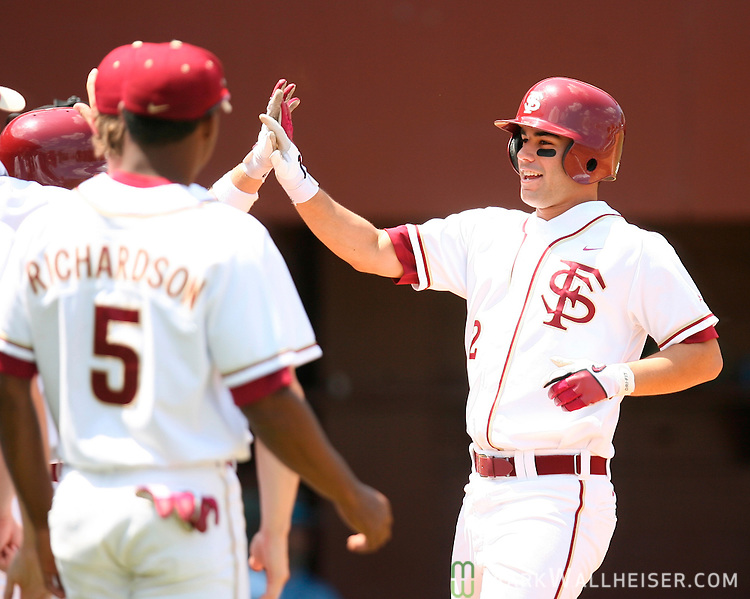 Ohmed Danesh, right, receives high-fives after hitting a home run in the bottom of the fourth inning as FSU beat North Carolina 5-4 in the second of the three game series at Dick Howser Stadium  in Tallahassee Saturday April 21, 2007.  (Mark Wallheiser/TallahasseeStock.com)