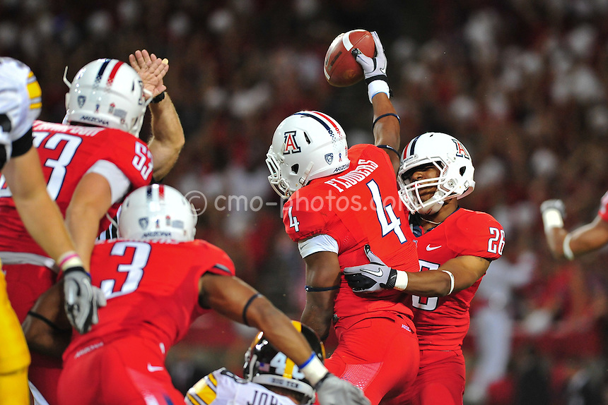 Sept 18, 2010; Tucson, AZ, USA; Arizona Wildcats safety Marquis Flowers (4) celebrates after recovering a blocked punt in the 1st quarter of a game against the Iowa Hawkeyes at Arizona Stadium.