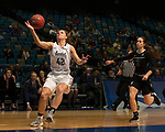 Idaho's Natalie Klinker grabs a long pass in front of Portland State's Kiana Brown in a women's Big Sky Tournament semi-final game held at the Reno Events Center on Friday, March 9, 2018 in Reno, Nevada.