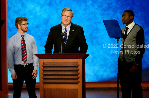 Former Governor Jeb Bush (Republican of Florida) makes remarks at the 2012 Republican National Convention in Tampa Bay, Florida on Thursday, August 30, 2012.  From left to right: Sean Duffy of Austin, Texas; Former Governor Bush; and Frantz Placide, a school choice beneficiary from Miami, Florida..Credit: Ron Sachs / CNP.(RESTRICTION: NO New York or New Jersey Newspapers or newspapers within a 75 mile radius of New York City)