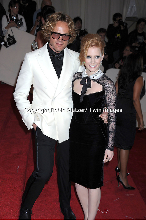 """Jessica Chastain and guest arriving at The Costume Institute Gala Benefit celebriting """"Alexander McQueen: Savage Beauty"""" at The Metropolitan Museum of Art in New York City on May 2, 2011."""