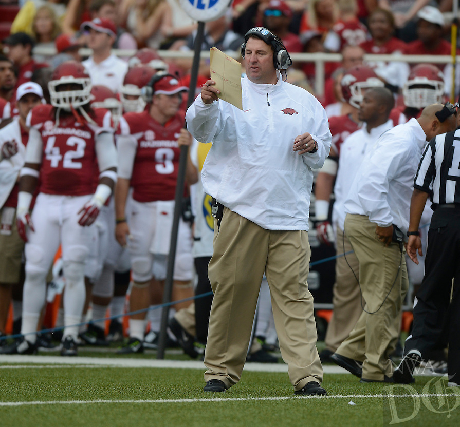 STAFF PHOTO ANTHONY REYES • @NWATONYR<br /> Bret Bielema, Arkansas head coach checks his sheets against Nicholls State in the first quarter Saturday, Sept. 6, 2014 at Razorback Stadium in Fayetteville.