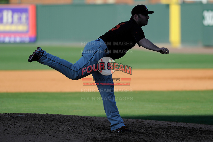Later afternoon shadows fall over pitcher Matthew Price (25) of the Delmarva Shorebirds in a game against the Greenville Drive on Monday, April 29, 2013, at Fluor Field at the West End in Greenville, South Carolina. Price pitched for the National Champion University of South Carolina Gamecocks. He was a seventh-round draft pick of the Baltimore Orioles in 2012. Delmarva won, 6-5. (Tom Priddy/Four Seam Images)