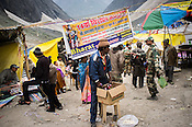 A vendor with his makeshift stall at the base of Amarnath Cave in Kashmir, India. Hindu pilgrims brave sub zero temperature and high latitude passes and make their pilgrimage to reach the sacred Amarnath cave, which houses a lingam - a stylized phallus, worshiped by Hindus as a symbol of God Shiva. Photo: Sanjit Das/Panos