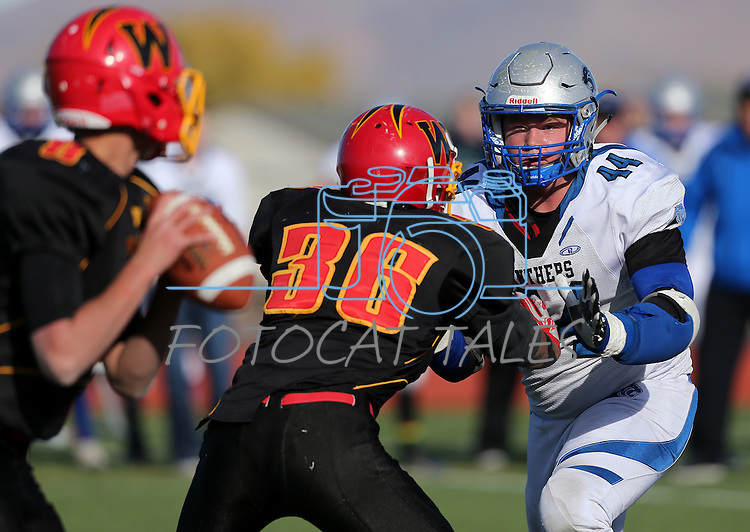 Pahranagat Valley's Garett Higbee pressures Whittell quarterback Colin Buchholz and Dimas Womack during the second half of the NIAA DIV championship game against Whittell High at Dayton High School in Dayton, Nev., on Saturday, Nov. 21, 2015. (Cathleen Allison/Las Vegas Review Journal)