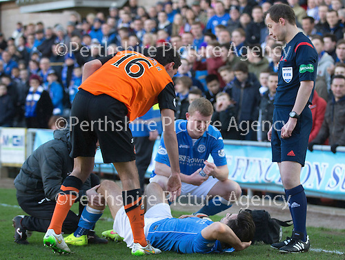 Dundee United v St Johnstone.....21.02.15<br /> Ryan McGowan goes over to check on Simon Lappin after his tackle that left the midfielder injured<br /> Picture by Graeme Hart.<br /> Copyright Perthshire Picture Agency<br /> Tel: 01738 623350  Mobile: 07990 594431