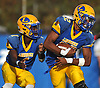 Chris Collier #22, Lawrence running back, right, takes a handoff from quarterback Christian Fredericks #1 during a Nassau County Conference III varsity football game against Bethpage at Lawrence High School on Saturday, Oct. 7, 2017. Collier scored three touchdowns while Fredericks ran for two in Lawrence's 35-31 win.