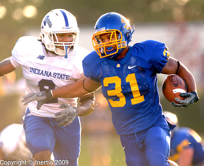 BROOKINGS, SD - SEPTEMBER 19:  Donye McCleskey #2 of Indiana State prepares to tackle Tyrel Kool #31 of SDSU Saturday at  Coughlin-Alumni Stadium. (Photo by Craig Johnson/Inertia)