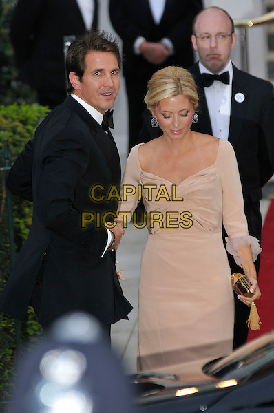 PRINCE PAVLOS AND PRINCESS MARIE CHANTAL OF GREECE.Gala pre-wedding dinner held at the Mandarin Oriental Hyde Park, London, England. 28th April 2011 in London, England..royal royalty kate catherine middleton prince william half length black suit beige dress.CAP/PL.©Phil Loftus/Capital Pictures..