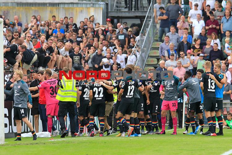 11.08.2019, Stadion Lohmühle, Luebeck, GER, DFB-Pokal, 1. Runde VFB Lübeck vs 1.FC St. Pauli<br /> <br /> DFB REGULATIONS PROHIBIT ANY USE OF PHOTOGRAPHS AS IMAGE SEQUENCES AND/OR QUASI-VIDEO.<br /> <br /> im Bild / picture shows<br /> Nach dem 6:7 Pokalsieg laesst sich die Mannschaft des FC St. Pauli von den Fans feiern.<br /> <br /> Foto © nordphoto / Tauchnitz