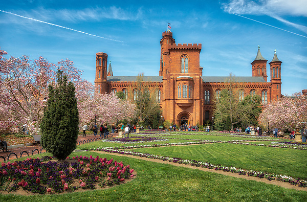 Smithsonian Castle Washington DC The Smithsonian Castle, located on the National Mall in Washington, D.C Nicknamed The Castle it was designated a National Historic Landmark in 1965. With multiple, rounded and curved towers, and massive, red sandstone masonry, the Castle serves as a stunning example of Romanesque style that is preserved as the oldest building on the National Mall.