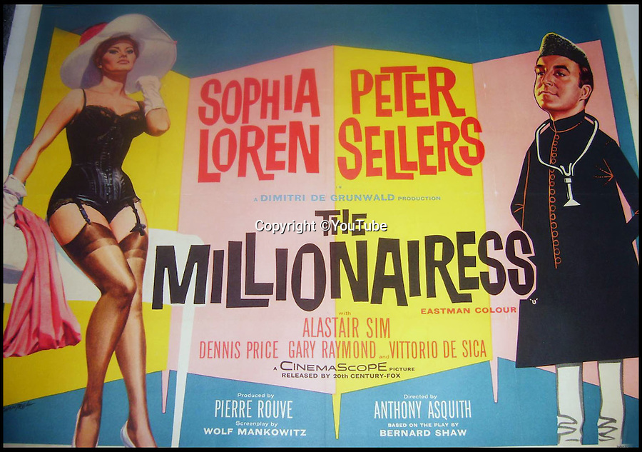 BNPS.co.uk (01202 558833)<br /> Pic: YouTube<br /> <br /> The little pink dress even featured on the billboard poster for the movie.<br /> <br /> Dressed to thrill - the stunning dress that led to Peter Sellers infatuation with screen goddess Sophia Loren is coming up for auction - but you may have to actually be a Miliionairess to afford it.<br /> <br /> Sophia Loren stripped off the salmon pink Balmain gown in a racy scene from the 1960 blockbuster 'The Millionairess' and unlikely leading man Peter Sellers was so entranced by the beautiful young italian star that he offered to leave his new wife for her.<br /> <br /> Dukes auctioneers in Dorchester are now selling the dress along with two others from the film and haute couture expert Antoinette Rogers says it could go for up to £10,000 thanks to its unique and glamorous provenance.
