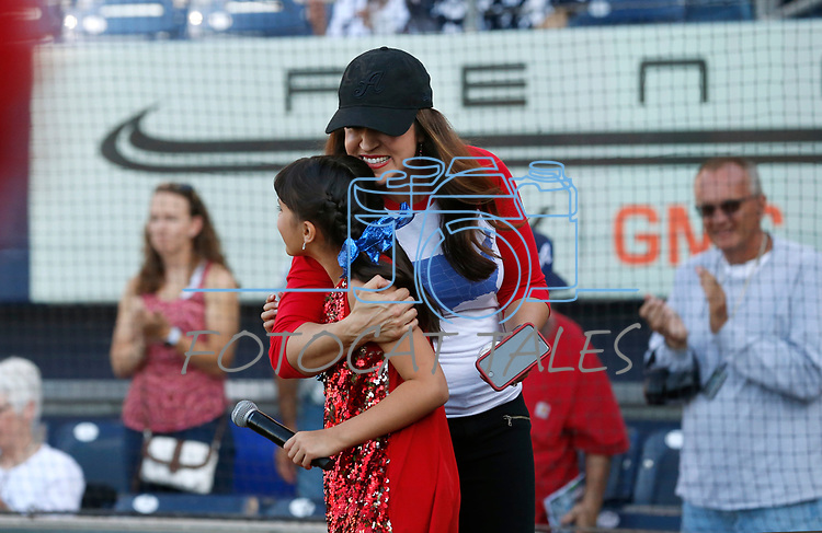 Kristen Remington hugs her daughter Brooklyn after she sings the National Anthem before the Sacramento River Cats game against the Reno Aces game, in Reno, Nev., on Thursday, July 4, 2019.<br /> Photo by Cathleen Allison/Nevada Momentum