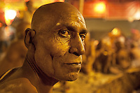 "India. Uttar Pradesh state. Allahabad. Maha Kumbh Mela. Hindu holy men of the Juna Akhara sect participate in rituals that are believed to rid them of all ties in this life and dedicate themselves to serving God as ""Naga"" or naked holy men. Portrait of a Naga Sadhu at night in Sangam. The Kumbh Mela, believed to be the largest religious gathering is held every 12 years on the banks of the 'Sangam'- the confluence of the holy rivers Ganga, Yamuna and the mythical Saraswati. The belief is that bathing and taking a holy dip will wash and free one from all the past sins, get salvation and paves the way for Moksha (meaning liberation from the cycle of Life, Death and Rebirth). In Hinduism, Sadhu (good; good man, holy man) denotes an ascetic, wandering monk. Sadhus are sanyasi, or renunciates, who have left behind all material attachments. They are renouncers who have chosen to live a life apart from or on the edges of society in order to focus on their own spiritual practice. The significance of nakedness is that they will not have any worldly ties to material belongings, even something as simple as clothes. This ritual that transforms selected holy men to Naga can only be done at the Kumbh festival. A Sadhu is usually referred to as Baba by common people. The Maha (great) Kumbh Mela, which comes after 12 Purna Kumbh Mela, or 144 years, is always held at Allahabad. Uttar Pradesh (abbreviated U.P.) is a state located in northern India. 6.02.13 © 2013 Didier Ruef"