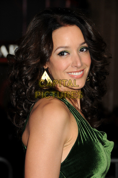 "JENNIFER BEALS .at Alcon Entertainment's L.A. Premiere of ""The Book of Eli"" held at The Chinese Theatre in Hollywood, California, USA, January 11th 2010. .portrait headshot green velvet smiling looking over shoulder side gold earrings dangly .CAP/ADM/BP.©Byron Purvis/AdMedia/Capital Pictures."