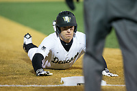 Nick DiPonzio (7) of the Wake Forest Demon Deacons slides head first into third base during the game against the Kent State Golden Flashes in game two of a double-header at David F. Couch Ballpark on March 4, 2017 in  Winston-Salem, North Carolina.  The Demon Deacons defeated the Golden Flashes 5-0.  (Brian Westerholt/Four Seam Images)