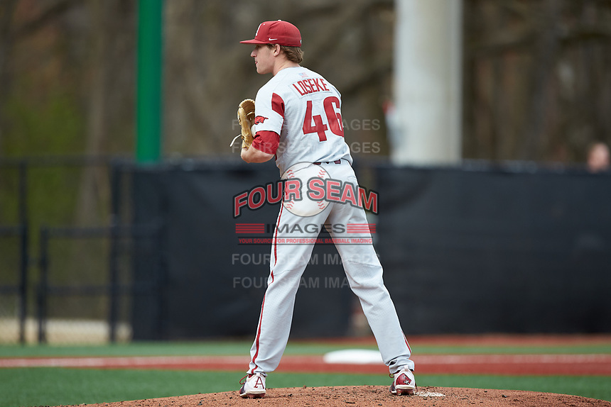 Arkansas Razorbacks starting pitcher Barrett Loseke (46) looks to his catcher for the sign against the Charlotte 49ers at Hayes Stadium on March 21, 2018 in Charlotte, North Carolina.  The 49ers defeated the Razorbacks 6-3.  (Brian Westerholt/Four Seam Images)