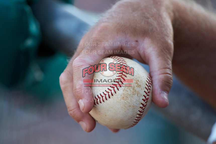 Lexington Legends bench coach Glenn Hubbard (17) holds a baseball in his hand during the game against the West Virginia Power at Appalachian Power Park on June 7, 2018 in Charleston, West Virginia. The Power defeated the Legends 5-1. (Brian Westerholt/Four Seam Images)