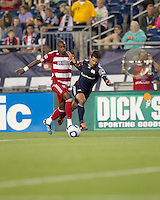 FC Dallas midfielder Jackson Goncalves (6) fouls New England Revolution midfielder Benny Feilhaber (22) as he drives for the net. In a Major League Soccer (MLS) match, the New England Revolution defeated FC Dallas, 2-0, at Gillette Stadium on September 10, 2011.