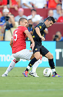 FC Barcelona forward David Villa (7) shields the ball against Manchester United defender Nemanja Vidic (15) Manchester United defeated Barcelona FC 2-1 at FedEx Field in Landover, MD Saturday July 30, 2011.