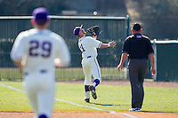 High Point Panthers first baseman Spencer Angelis (11) makes a running catch down the right field line against the Bowling Green Falcons at Willard Stadium on March 9, 2014 in High Point, North Carolina.  The Falcons defeated the Panthers 7-4.  (Brian Westerholt/Four Seam Images)