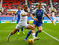 Leeds United's Kemar Roofe vies for possession with Wigan Athletic's Dan Burn<br /> <br /> Photographer Alex Dodd/CameraSport<br /> <br /> The EFL Sky Bet Championship - Wigan Athletic v Leeds United - Sunday 4th November 2018 - DW Stadium - Wigan<br /> <br /> World Copyright &copy; 2018 CameraSport. All rights reserved. 43 Linden Ave. Countesthorpe. Leicester. England. LE8 5PG - Tel: +44 (0) 116 277 4147 - admin@camerasport.com - www.camerasport.com