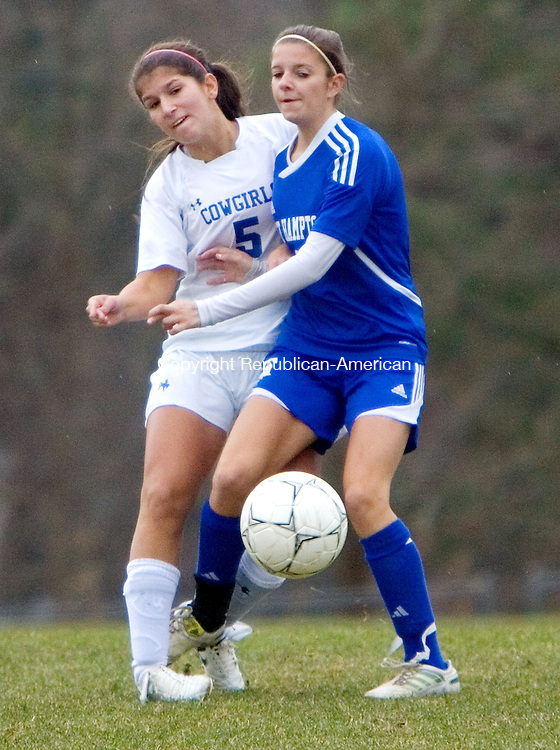 LITCHFIELD, CT. 15 November 2011-111511SV15--#5 Ellie Motta of Litchfield High gets tied up with #7 Cassandra Easter of East Hampton during CIAC soccer quarterfinal action in Litchfield Tuesday.<br /> Steven Valenti Republican-American