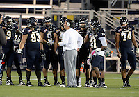 Florida International University Defensive Coordinator Todd Orlando talks to his players during the Spring Game on March 30, 2012 at Miami, Florida. .