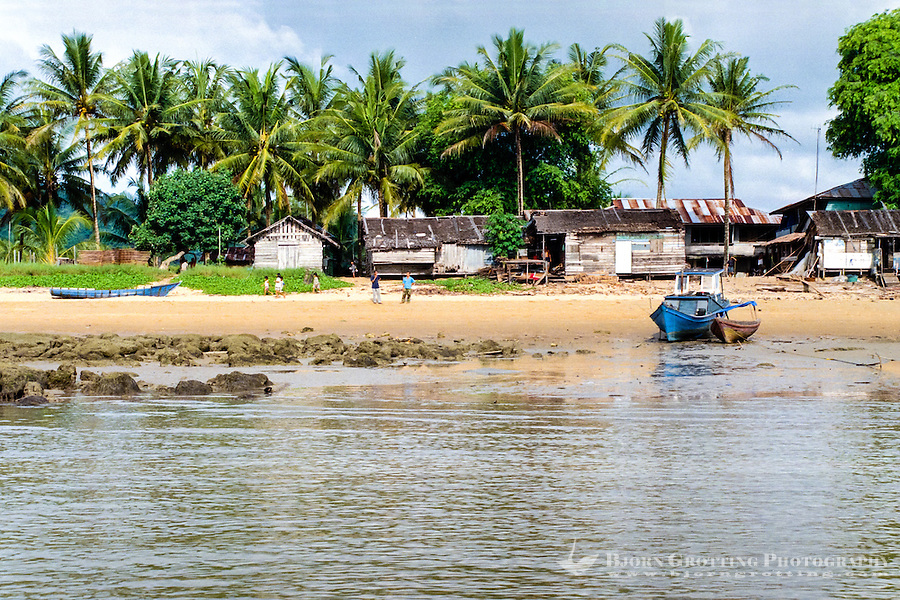 Kalimantan, Tanjung Datu. Small village close to the Malaysian border. Fishing vessel on the beach.
