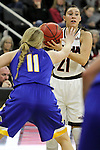 OMAHA, NE - FEBRUARY 4TH, 2016 - University of Nebraska Omaha's Abi Lujan #21 looks for an open teammate over the hands of Madison Guebert #11 of South Dakota State during their game Thursday evening at Baxter Arena in Omaha, NE. (Photo By Ty Carlson/Inertia)