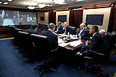 United States President Barack Obama talks with Prime Minister Nouri al-Maliki of Iraq during a secure video teleconference in the Situation Room of the White House, Friday, October 21, 2011. Seated at the table, from left, are: Tony Blinken, National Security Advisor to the Vice President ; National Security Advisor Tom Donilon; Puneet Talwar, Senior Director for Iraq, Iran and the Gulf States; Deputy National Security Advisor Denis McDonough; and Chief of Staff Bill Daley. Pictured on screen, from left, are: Prime Minister al-Maliki, along with two aides; Vice President Joe Biden; and General Lloyd Austin, Commanding General of U.S. Forces - Iraq; and U.S. Ambassador to Iraq James Jeffrey. .Mandatory Credit: Pete Souza - White House via CNP