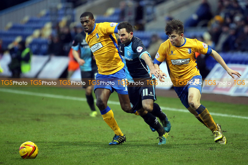 Wycombe's Sam Wood bursts through the Mansfield defence - Mansfield Town vs Wycombe Wanderers - Sky Bet League Two Football at the One Call Stadium, Mansfield - 25/01/14 - MANDATORY CREDIT: Paul Dennis/TGSPHOTO - Self billing applies where appropriate - 0845 094 6026 - contact@tgsphoto.co.uk - NO UNPAID USE