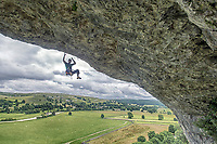 Neil Gresham on Freakshow 8c at Kilnesey, UK <br /> The great brooding limestone cliff of Kilnsey is recognised as one of the UK&rsquo;s most impressive crags. Its most distinctive feature is an enormous roof that caps the already severely overhanging South Buttress. This feature was first aid climbed in the 50s but shot to prominence in 1988 when it was freed by Mark Leach to give Mandela &ndash; so named as &lsquo;they said it would never go free&rsquo;. This summer Neil Gresham added his own take on Kilnsey Main Overhang but at a much higher grade with his route Freakshow. 8c in difficulty Freakshow is very different to your typical British sport route &ndash; almost 40m in length and with 18 clips the route climbs like the Spanish ultra endurance routes currently defining modern sport climbing. Success for Neil came after 14 days of effort.